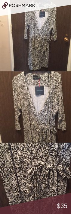 CYNTHIA ROWLEY BLACK & WHITE PRINT WRAP DRESS  NEW Faux wrap 3/4 length sleeves ties on the side. Has a v- neckline and the skirt falls below my knees. Black and white print.  New Cynthia Rowley Dresses