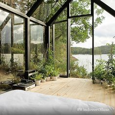 Tag a budding gardening enthusiast who would go green with envy for this view. Credit to: Architect: Ville Hara. Designer: Linda Bergroth. http://bit.ly/23wXktv #WindovertMuse #Design #Inspiration #Architecture #Greenhouse