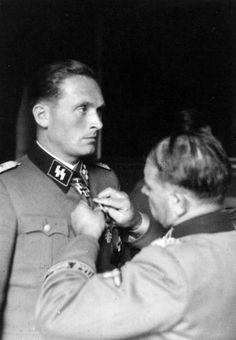 """SS-Brigadeführer and Generalmajor of the SS Theodor Peter Johann Wisch (13 Dec 1907 – 11 Jan 1995) Knight's Cross on 15 Sep 1941 as SS-Sturmbannführer and commander of the II./""""Leibstandarte SS Adolf Hitler""""; 393rd Oak Leaves on 12 Feb 1944 as SS-Brigadeführer and Genmajor of the SS, and commander of the 1. SS-Panzer-Division """"Leibstandarte SS Adolf Hitler""""; 94th Swords on 30 Aug 1944 as SS-Brigadeführer and Genmajor of the SS, and commander of the 1. SS-Panzer-Division """"Leibstandarte SS AH"""""""