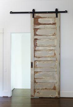 Use barn door hardware to hang an old chippy door. Jan Ware Designs