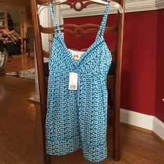 NWT FOREVER 21 Tank NWT blue/white patterned tank!! Cute detail on top and bottom trim (in pictures). Soft material. Size small! Forever 21 Tops Tank Tops