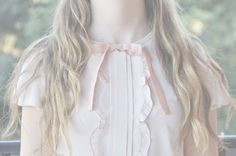 A very classic and cute top with the ruffles and the pastel pink ribbon around the neck.