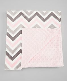 Thanks to its soft minky construction and colorful print, this blanket offers a luxuriously soft swaddle for sleepy sweeties. Best of all, it's made in the USA and can be tossed in the wash for effortless care.