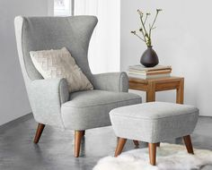 With an overall classic profile, the lines of the Katja high back chair add visual interest to your space. Carve out a special corner for this comfortable and roomy design. The tailored wingback style rests atop solid beech tapered legs with a walnut veneer for a mid-century modern touch.  Purchase online at SCANDIS.com