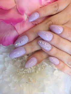 Almond shaped nails with lilac gel polish and Swarovski crystals