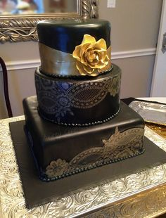 Black and Gold Lace Wedding Cake by The Cake Chic, via Flickr