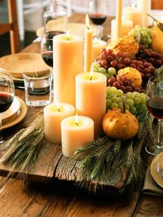 Abundant Harvest  For a bountiful and modern cornucopia, arrange a mix of candles and fresh fruit and vegetables on a rustic wooden slab.