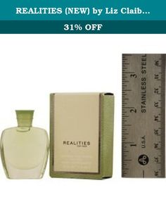 REALITIES (NEW) by Liz Claiborne for MEN: COLOGNE .18 OZ MINI (note* minis approximately 1-2 inches in height). REALITIES (NEW) by Liz Claiborne for MEN COLOGNE .18 OZ MINI Launched by the design house of Liz Claiborne in 2004, REALITIES (NEW) by Liz Claiborne possesses a blend of Madarin, Tea, Sueded Cedar Wood, Wet Greens, Nutmeg, Ginger, Cashmere Woods, Italian Grapefruit. It is recommended for casual wear.