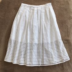 Sale - MK white cut out skirt  Beautiful skirt .. Mid length but have cut outs all over with white lining  Michael Kors Skirts Midi