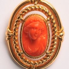 Coral cameo brooch of a woman in profile to the right. The very finely carved cameo in high relief has been set in a triple bordered mounting of 18 carat yellow gold.  33 x 44mm.  www.osprey.fr  €1150 Vintage Jewelry, Carving, Profile, Paris, Jewels, Woman, Yellow, Gold, Coral