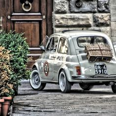 Here's another one. Friends together all with the same picnic idea. Classic Fiat 500?!