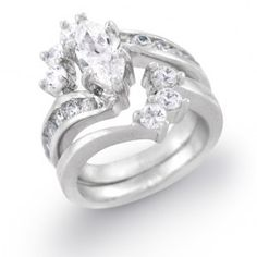 marquis cut diamond engagement ring with offset round diamond wedding band.