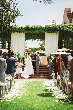 Lovely destination wedding at the Sonoma Golf Club in Sonoma, CA. Reverend Rick Tan officiant and harp. Jennifer Tan flute. Photo by The Mou Studio.