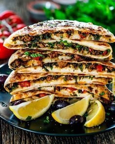 Turkish Gozleme with Lamb - savoury homemade flatbreads from scratch filled with ground lamb, spices, herbs and feta cheese. You won't be able to eat just one! #turkish #food #gozleme