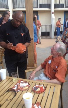 TYLER: Texas Football head coach Charlie Strong signs a hat for a fan on Thursday, April 24 at the Holiday Inn in Tyler. [2014 Texas Comin' on Strong Tour: Tyler]