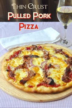 Thin Crust Pulled Pork Pizza -one of the best reasons to make slow cooked pulled pork is to enjoy the leftovers on this fantastically flavourful pizza.