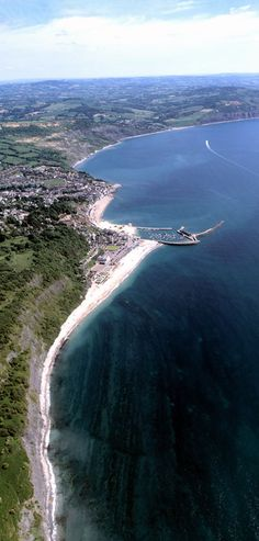 Stunning aerial view of Lyme Regis, UK Jurassic coast, fossil hunting Lyme Bay, Dorset Coast, Fossil Hunting, Lyme Regis, Dorset England, English Channel, Jurassic Coast, Holiday Places, Birds Eye View