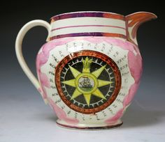 Antique pink luster pottery pitcher with nautical related decorations c1820