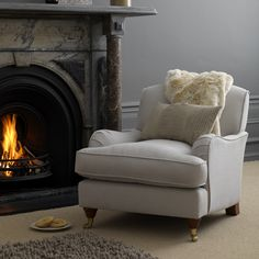 This classic design is available in our 42 house fabrics with natural feet. You can also order in any fabric in store Shown here in Romo Linara Silver Made in our own factory in Northumberland. Also available in store as a bespoke option in hundreds of fabric finishes.
