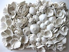 Working from a tiny table in the nook of her living room, California-based artist Angela Schwer crafts explosive dahlias, gardenias, poppies, fungi, and sea creatures all from a custom blend of polymer clays. Meant primarily as decorative objects, the dense handmade pieces are surprisingly detaile