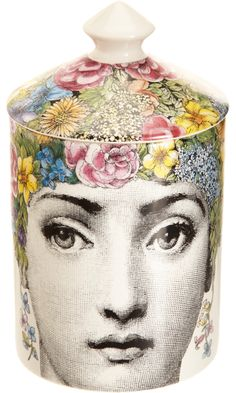 Fornasetti Flora Candle /  Lush combination of ivy, jasmine, and lily of the valley. Candle burns 60 hours. Afterwards, the container could be used to hold any number of items. I envision it sitting on my vanity holding makeup brushes.