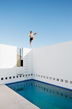 Thomas Hyland jumping into the pool of the Dialogue house. photos by: Dean Kaufman