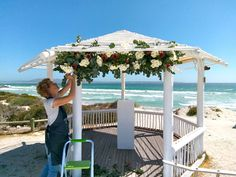 We are really looking forward to the summer wedding season. If you've worked with us, you'll know that Nicky and her team always go the extra mile to ensure the flowers are perfect on your special day.   Here she is pictured creating a beautiful canopy under the gazebo for Marelien's beach wedding last summer.   Visit our website to book an appointment: www.fabulousfynbos.co.za Gazebo Pergola, Garden Gazebo, Go The Extra Mile, Wedding Gazebo, Wedding Season, Canopy, Summer Wedding, Wedding Bouquets, Flower Arrangements
