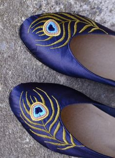 The upper part of these shoes is made of beautiful 100% silk. The color is indigo. The peacock is embroidered BY HAND. NO EMBROIDERY MACHINE IS USED. The inner sole is made of lining leather making these shoes very comfortable. The middle sole and outsole are made of leather and treated with wax for protection against water and dirt. photo 1/4