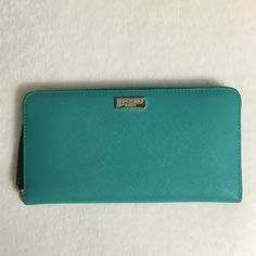 Kate spade Neda Newbery Lane Wallet Zip around wallet, lots of room for bills, cards even a cellphone can fit inside. Saffiano leather. kate spade Bags Wallets