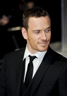 Michael Fassbender:tired but still maintaining high standards in the Adonis department.   :-)