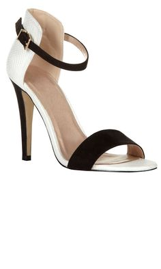 I am in LOVE with these black and white heels