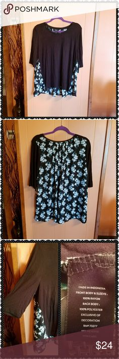Beautiful flowy blouse. This top is unique. The back of the shirt has a beautiful floral pattern that wraps around the front a little bit on the bottom. The front of the shirt and the sleeves are solid black. It is an a-line style and is flowy. With 3/4 sleeve. No, photo number 4 is not blurry. That is the actual pattern on the shirt. Machine washable. Simply Vera Vera Wang Tops Blouses