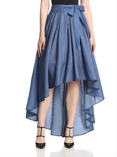 """Pleated chambray skirt with hidden back zipper, attached self-tie sash, tulle underskirt for fullness and high-low hem Care instructions: Hand wash Measurements: waist to hemline 27"""", taken from size M Country of origin: China Model's measurements: Height 5'10"""", Bust 32"""", Waist 26"""", Hips 37"""", wearing a size Small Fabric: 100% Cotton Please select address at checkout to verify international shipping eligibility"""