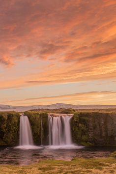 Sunset over the waterfalls of Iceland