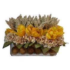 """Bring a touch of natural style to your dining table or foyer with this lovely silk tulip arrangement, nestled in a glass vase featuring faux citrus accents.    Product: Faux floral arrangementConstruction Material: Silk, plastic, acrylic and glassColor: Yellow, ivory and greenFeatures: Includes faux tulips and lemonDimensions: 12"""" H x 20"""" W x 10"""" D"""