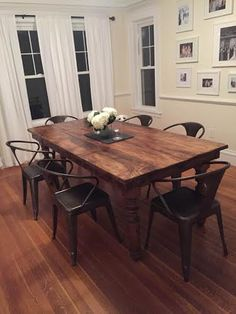Kitchen or dining-room farmhouse table made using reclaimed barn wood, rough cut wood, and thick, sturdy Osborne Wood legs. Tables are