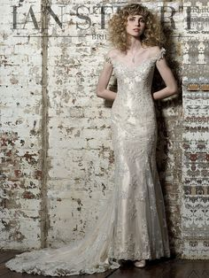 A vintage gown in taffeta cangiante and beaded French lace. The fitted bodice has a flattering sweetheart neckline and lace-covered shoulder straps. The gown is covered throughout with the finest French lace, embellished with sequins and beads. The mermaid skirt and train have godet panels, creating a beautiful swirling effect when you walk in this …