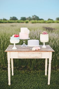 Love this cake display. Such a pretty use of antique furniture! {Photo by onelove photography for Project Wedding}