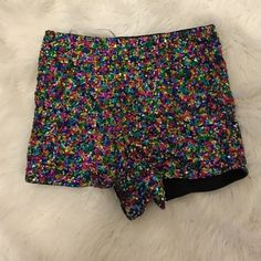 Sequins high waisted shorts Multi-Colored sequins high waisted  shorts. They are sexy and cute. Perfect for the club sene .100% polyester .  Charlotte Russe Shorts
