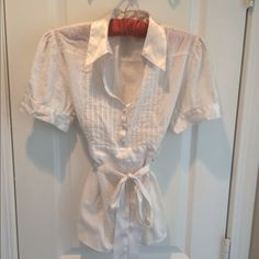 Apt 9 White Blouse Sz Large Cute blouse by Apt 9. This V-neck collared top Has self tie sash, button detail on short sleeve , and tuxedo pleats on front. Very Gently worn (1 or 2 times). Apt. 9 Tops Blouses