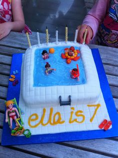 Ella asked for a swimming pool cake for her swimming pool party.  I gulped. But with tips gleaned from pinterest (and some handy playmobil) I made this.  I was so chuffed I couldn't bear to cut it for two days!