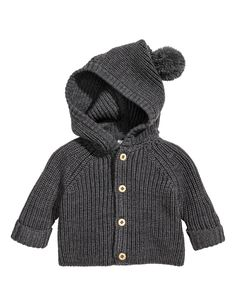 Rib-knit cardigan in the softest merino wool with a hood with a pompom on the top, buttons down the front and long raglan sleeves with sewn-in turn-ups. Baby Outfits Newborn, Baby Boy Outfits, Kids Outfits, Baby Cardigan, Wool Cardigan, Baby Vest, Baby Boy Fashion, Kids Fashion, Kids Clothes Patterns