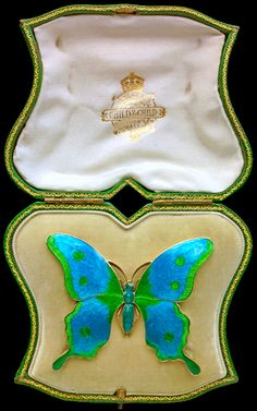 An Art Nouveau CHILD & CHILD 1880-1915 Butterfly Brooch   Gilded silver, gold & enamel Length: 5 cm  Width: 6 cm (2 x 2.4 in)  Marked: 'Child & Child' monogram CC with sunflower English. C.1900