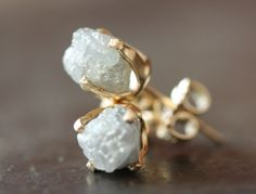 pair of  rough diamond earrings from Alexis Russel, designer based in New York City.