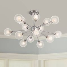 Inspired by Sputnik-style light fixtures, this chandelier features glass balls with halogen bulbs. 30 wide x 16 high. Canopy is wide. Each bulb has a 260 lumen light output. Style # at Lamps Plus. Glass Ceiling Lights, Ceiling Light Fixtures, Modern Ceiling Lights, Sphere Light Fixture, Living Room Lighting, Bedroom Lighting, Bedroom Ceiling, Interior Lighting, Lighting Ideas