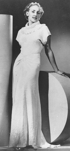 Model posing in a glamorous 1930s evening gown by State Library of Queensland, Australia, via Flickr