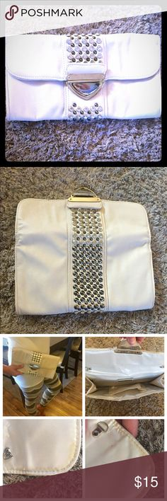 MMS Off White Studded Large Clutch MMS Off White Studded Large Clutch; NOT FOSSIL - BRAND ONLY USED FOR EXPOSURE; Gently used; has some where (as shown in pictures) on the inside corners of purse with discoloration; chain is missing that use to attach to purse, but any purse chain/strap could easily be attached; no studs are missing; still has lots of life left! Fossil Bags Clutches & Wristlets