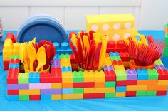 LEGO Birthday Party! Cupcakes with cute LEGO head toppers and candy blocks + LEGO centerpieces.