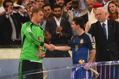 Golden Glove winner Manuel Neuer of Germany shakes hands with Golden Ball winner Lionel Messi of Argentina after Germany's 10 win in extra time...