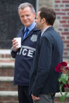 Elementary Stars Jonny Lee Miller (Sherlock Holmes) and Aidan Quinn (Captain Gregson) on set